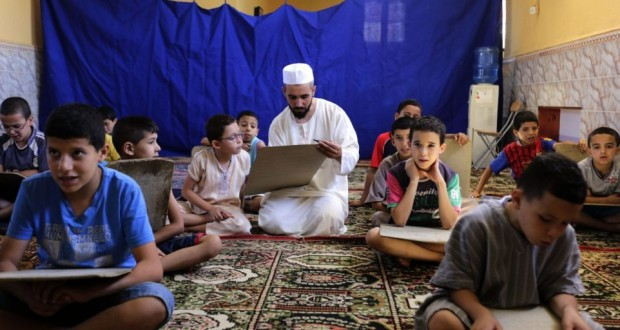 Pupils read and learn the Koran during the holy fasting month of Ramadan, at a mosque in Kheraisia, east of Algiers