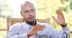 Saif Al-Islam, son of Libyan leader Muammar Gaddafi, speaks of oil recovery round during an interview in Nice